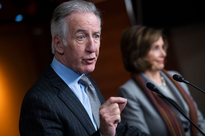 House Ways and Means Chairman Richard Neal (D-Mass.) speaks as his ally, House Speaker Nancy Pelosi (D-Calif.), looks on. His