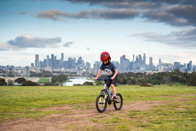 A boy rides bicycle in Melbourne, Victoria,