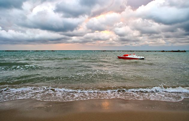 Sea with boat and cloudy