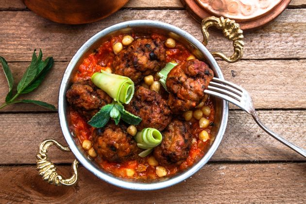 Arabian meatballs kofte with chickpeas, spicy tomato sauce and