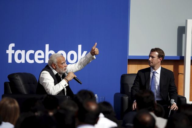 Indian Prime Minister Narendra Modi (L) and Facebook CEO Mark Zuckerberg speak on stage during a town...
