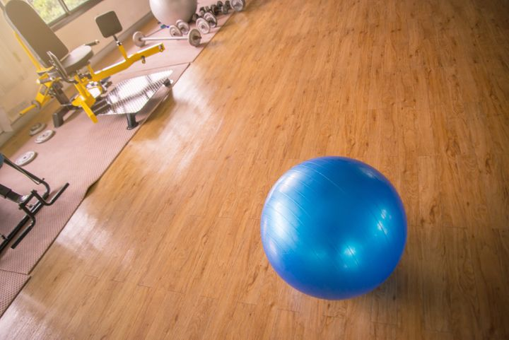 High Angle View Of Fitness Ball On Hardwood Floor In Gym