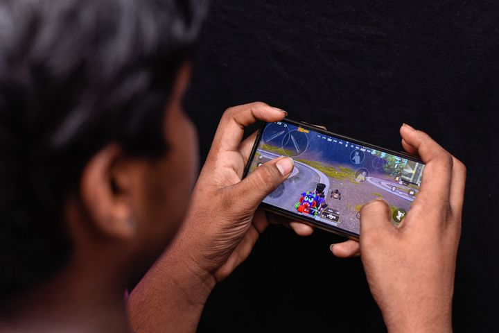 A boy playing PUBG on his smartphone.