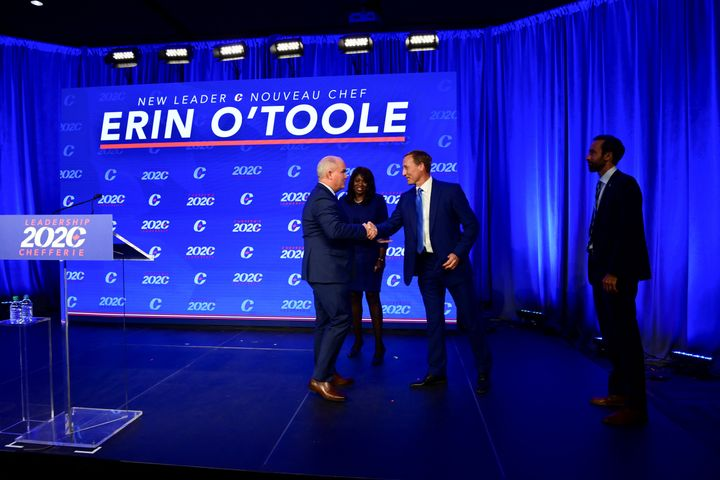Erin O'Toole greets fellow candidates Peter MacKay and Leslyn Lewis after being elected leader of the federal Conservative party.