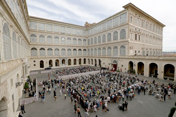 Catholics listen to Pope Francis during his general audience at the San Damaso courtyard, at the Vatican, Wednesday, Sept. 2,