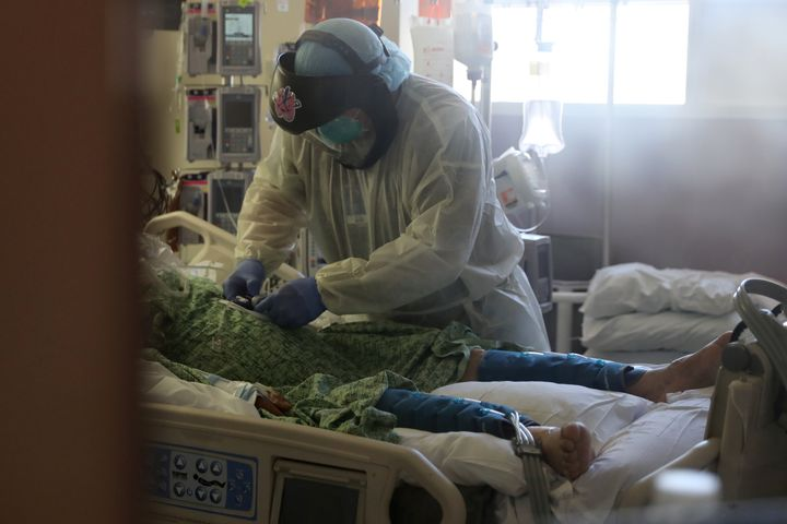 A patient suffering from COVID-19 is treated in the Intensive Care Unit at Scripps Mercy Hospital in Chula Vista, California,