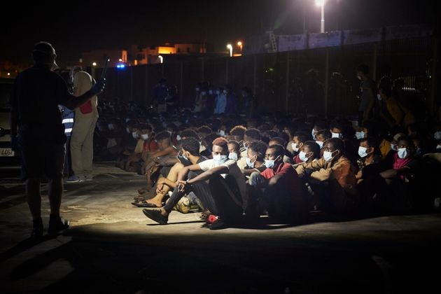 LAMPEDUSA, ITALY - AUGUST 30: A group of 450 migrants coming from sub-Saharan Africa who left Libya on...