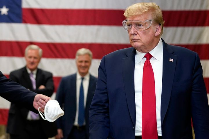 President Donald Trump participates in a tour of a Honeywell International plant that manufactures personal protective equipment on May 5, 2020, in Phoenix.