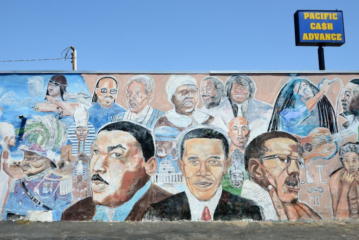 "You're far more likely to read ""African American"" in history books, but many feel that Black is more inclusive to Caribbean and Central and South American people of color. Here, a mural in South Central Los Angeles highlights Black historical figures of the past and present."