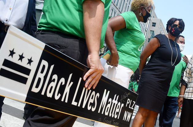 Mayor Muriel Bowser waits at Black Lives Matter Plaza to watch the funeral procession for Congressman...