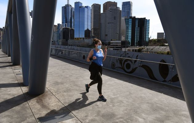 People exercise on the edge of Melbourne's central business district on September 1, 2020, with the city...