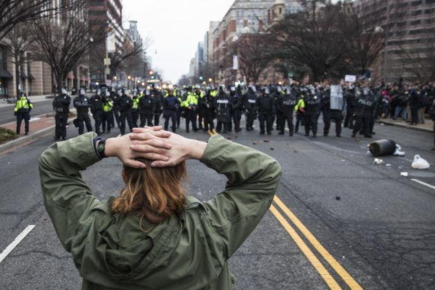 Anti-Trump protesters face off with police after Donald Trump was sworn into office in Washington, D.C....