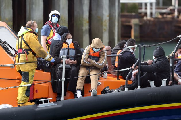 A group of people thought to be migrants are brought into Dover, Kent, by the RNLI following a small...
