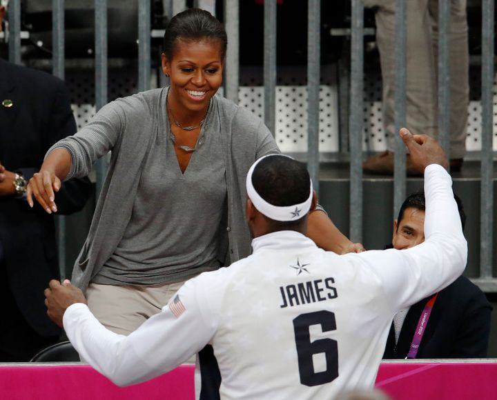 Michelle Obama and LeBron James greet each other during the 2012 Olympics.