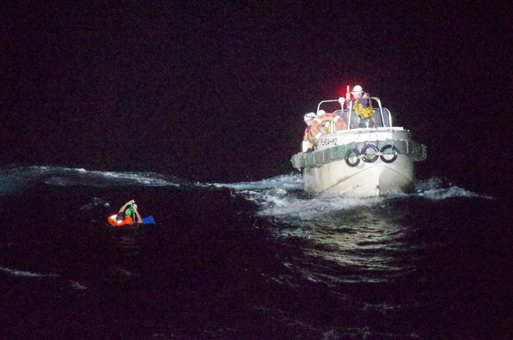 A Filipino crew member believed to be onboard Gulf Livestock 1 is seen being rescued by a Japan Coast Guard boat.