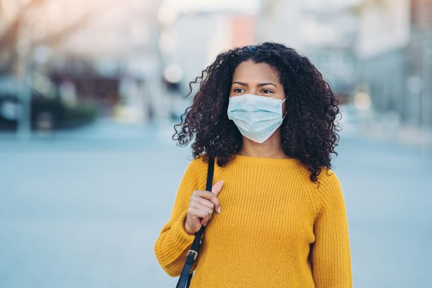 Wearing a mask and staying away from other people will likely be a part of Canadians' lives for...