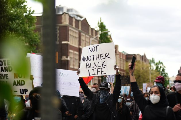 Protesters chanting during a Toronto rally to protest police-involved deaths in North America on May...