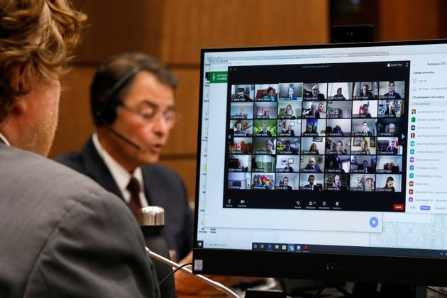 Canadian Members of Parliament, displayed on a computer monitor, attend the first virtual meeting of...