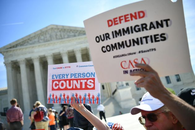 Demonstrators rally at the U.S. Supreme Court in April 2019 to protest a proposal to add a citizenship...