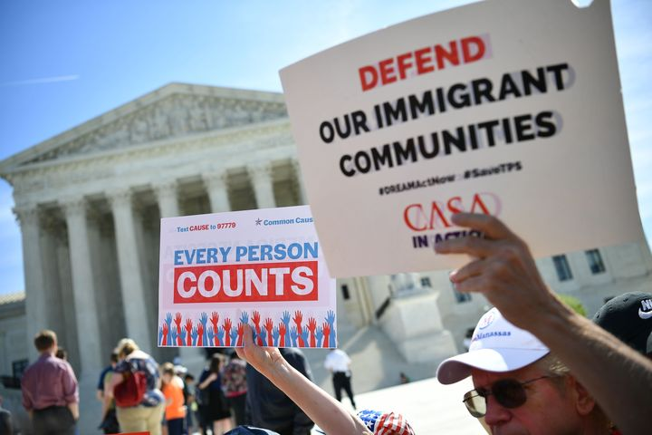 Demonstrators rally at the U.S. Supreme Court in April 2019 to protest a proposal to add a citizenship question to the 2020 c