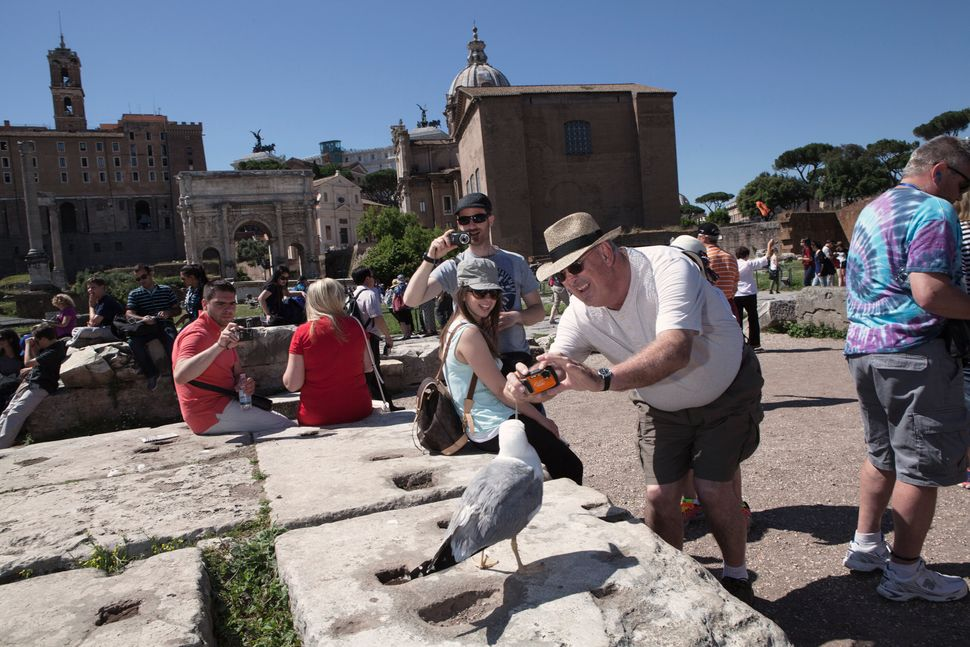 According to the Italian Ministry of Cultural Heritage and Activities, in 2019, more than 55 million tourists visited museums and archeological sites in Rome, such as the Roman Forum, pictured here. Access to the site has been restricted to reservation-only. Above: May 29, 2015 | Below: July 31, 2020