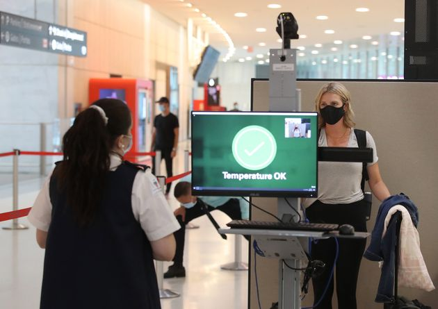 Passengers are temperature screened at the departure gates at Pearson International Airport on July