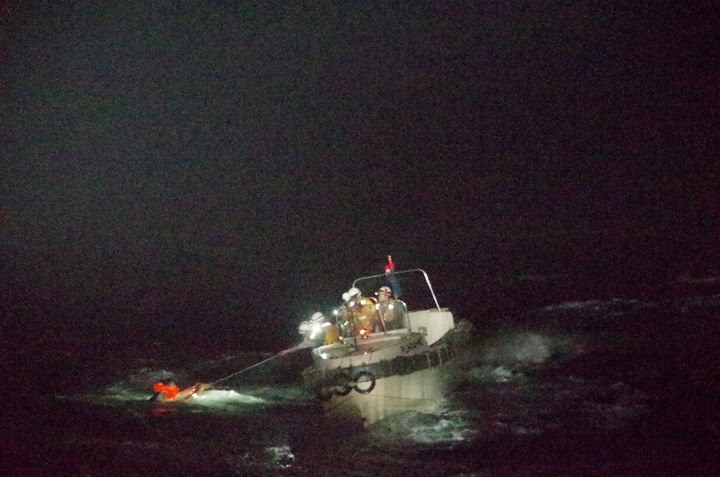 A Filipino crew member believed to be onboard Gulf Livestock 1, a cargo ship carrying livestock and dozens of crew members that went missing after issuing a distress signal due to Typhoon Maysak, is rescued by a Japan Coast Guard boat.