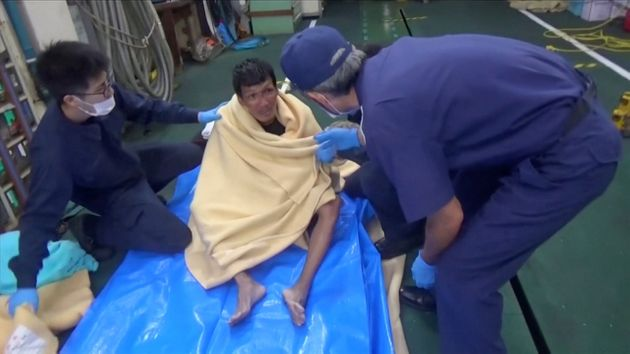 A Filipino crew member from the missing livestock ship, Gulf Livestock 1, is seen after being rescued...