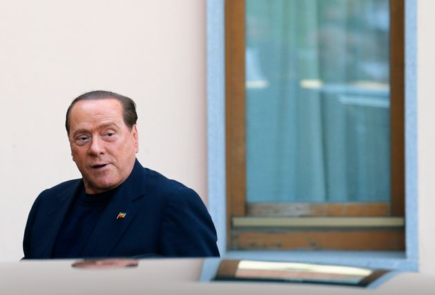 Former Italian Prime Minister Silvio Berlusconi looks on as he arrives at the Sacred Family Foundation,...