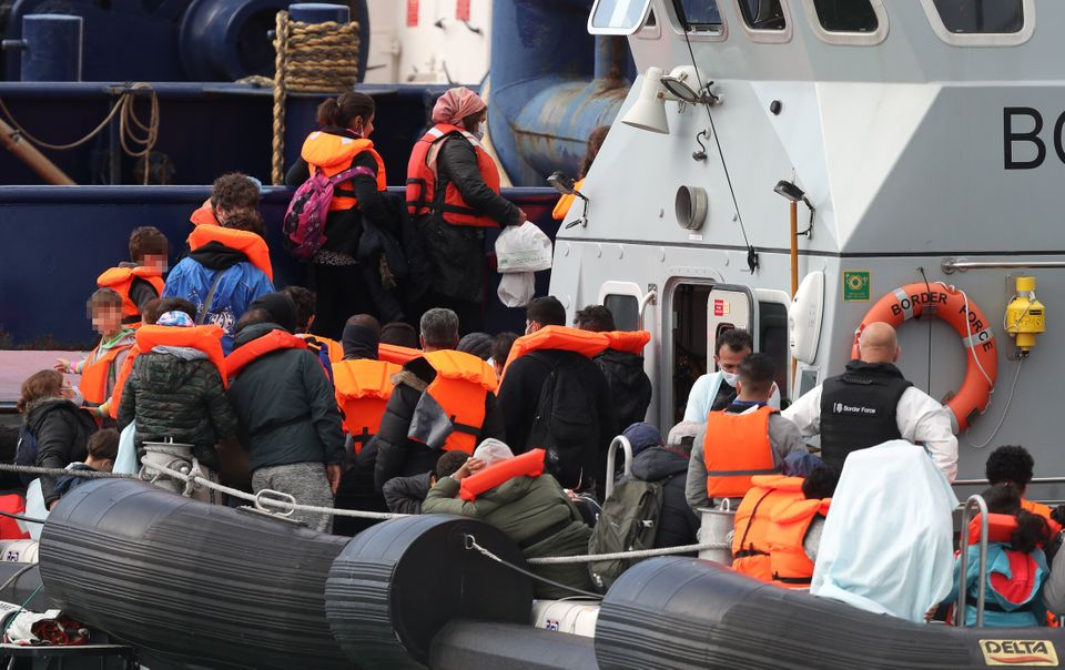 A group of people thought to be migrants are brought into Dover, Kent, by Border Force officers following...