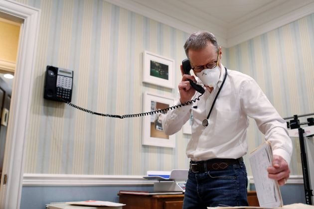 Dr Greg Gulbransen takes part in a telemedicine call with a patient while maintaining visits with both...