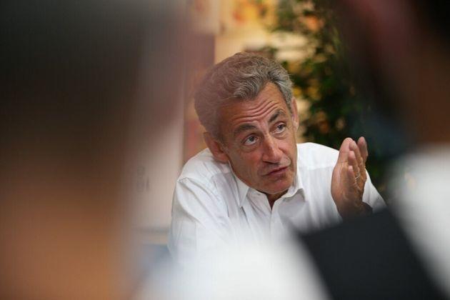Sarkozy (photographié ici le 24 juillet) soutient Raoult,