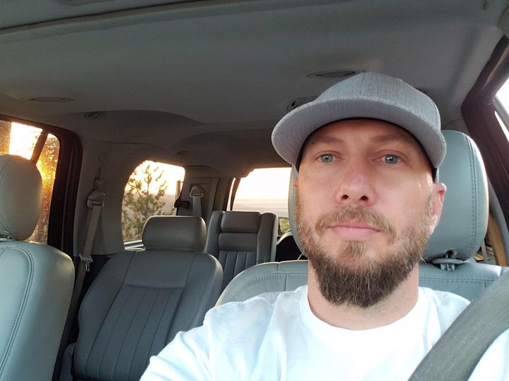 Activist Jeremy Logan, pictured here in his car, says unidentified officers in Spokane, Washington, abducted him as he walked