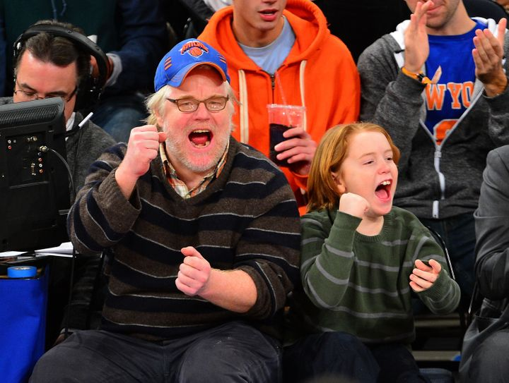 Philip Seymour Hoffman and Cooper Hoffman attend a Knicks game in January 2013.