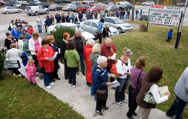 Residents line up for H1N1 vaccinations, administered by Peterborough Health Unit, at a branch of Royal Canadian Legion in rural Lakefield, Ont. on Oct. 29, 2009.