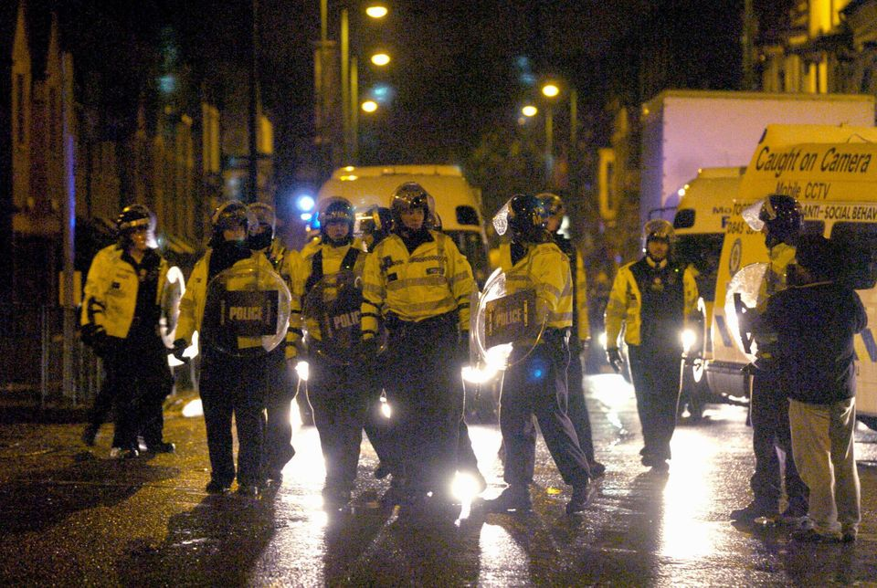 Police take to the streets during a second night of violence in Lozells, Birmingham, in October