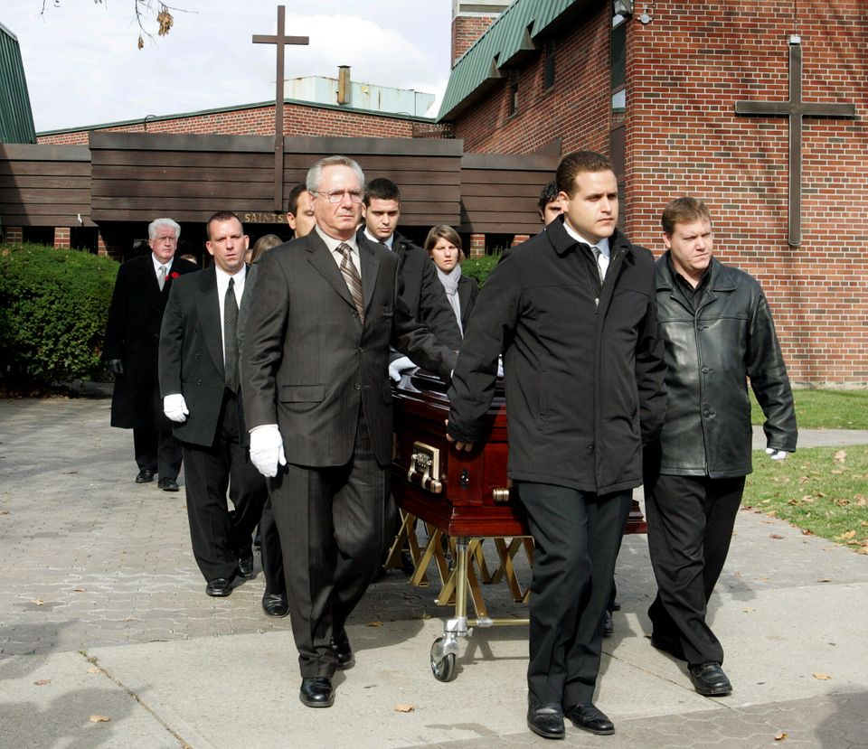 Pallbearers walk with the casket after funeral services for 13-year-old Evan Frustaglio in Toronto on...