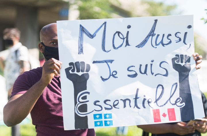 People take part in a protest outside Prime Minister Justin Trudeau's constituency office in Montreal on Aug. 15, 2020, where they called on the government to give permanent residency status to all migrant workers and asylum seekers.