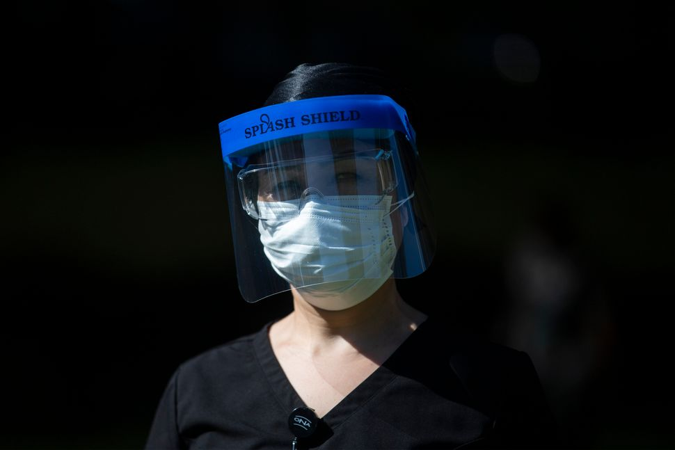 Registered Nurse, Shekiba Khedri, a healthcare worker at Birchmount Hospital, in Scarborough, Ont. is photographed wearing pe