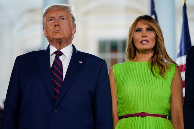 President Donald Trump and first lady Melania Trump stand on the South Lawn of the White House on the...