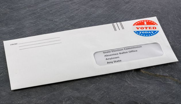 Envelope containing voting ballot papers being sent by mail for absentee vote in presidential