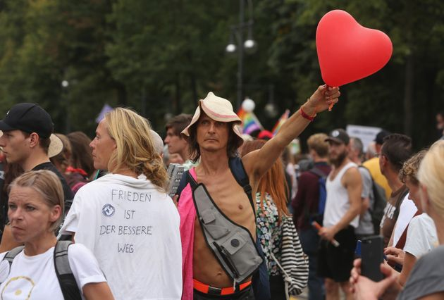 A protester holds a heart-shaped balloon as he takes part in an unregistered demonstration against government...