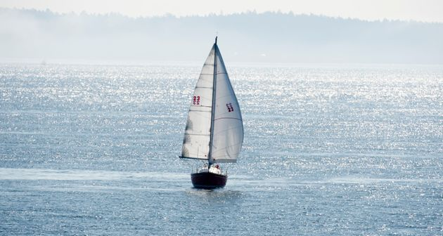 A sail boat is seen sailing off the shore of Vancouver Island on March 29, 2013. Foreign boaters should...