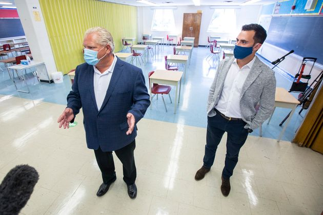 Ontario Premier Doug Ford, left, and Education Minister Stephen Lecce take a tour of Kensington Community...
