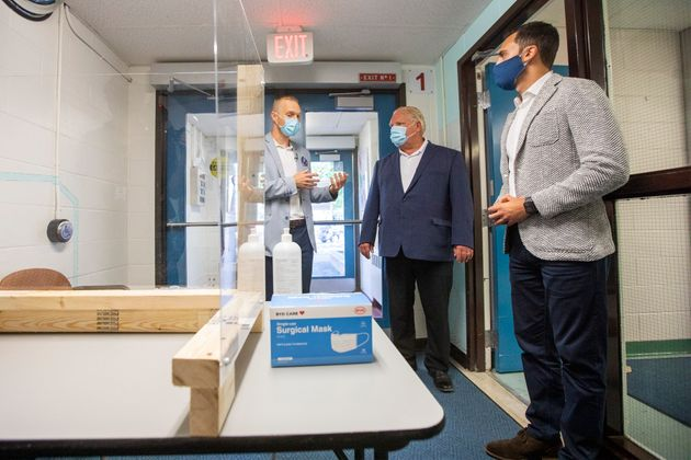 Principal Dan Fisher, left, of Kensington Community School gives a tour to Ontario Premier Doug Ford,...