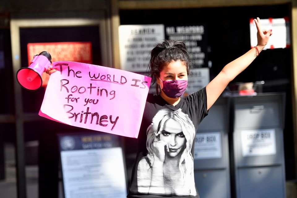 A supporter of Britney Spears gathers with others outside a courthouse in downtown LA for a #FreeBritney...