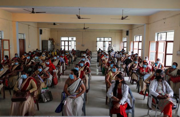 Health workers attend a training session on handling the coronavirus pandemic in villages in Fatehpur,...