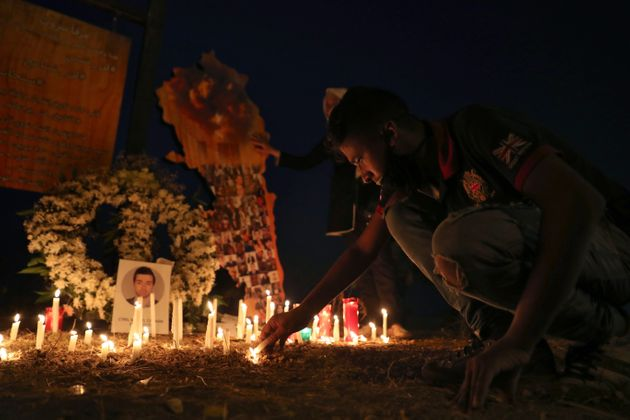 A man lights a candle near the seaport of Beirut, as he mark one month since the devastating Aug. 4 explosion...