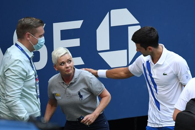 Novak Djokovic of Serbia and a tournament official tend to a linesperson who was struck with a ball by Djokovic against Pablo Carreno Busta of Spain (Mandatory Credit: Danielle Parhizkaran-USA TODAY Sports/Sipa USA