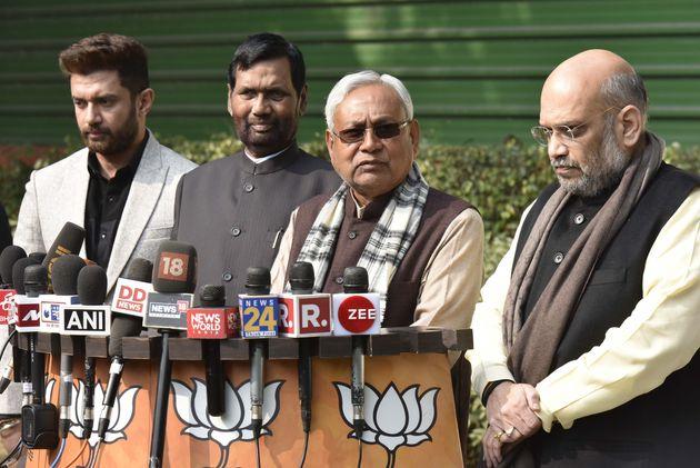 Bihar Chief Minister Nitish Kumar (2R), senior BJP leader Ram Vilas Paswan (2L) and his son Chirag Paswan...